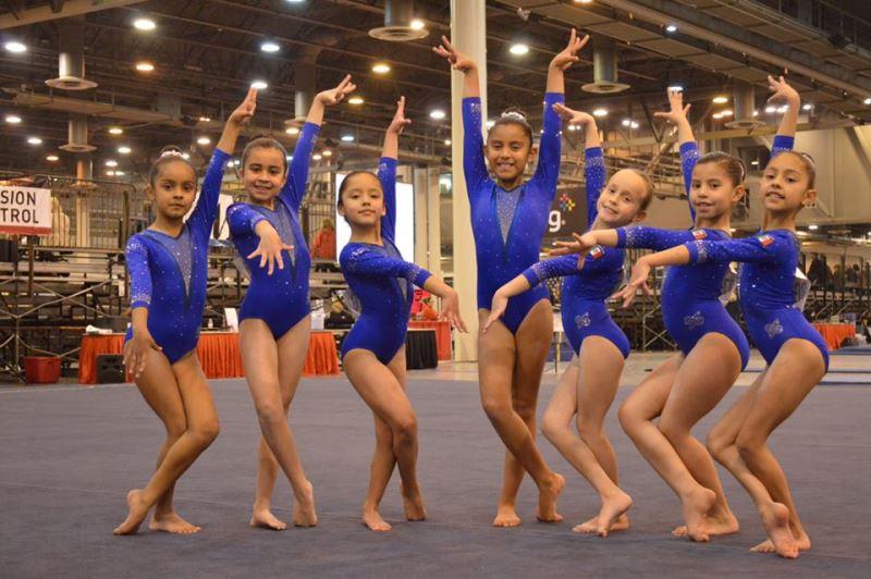 Gimnastas de la de Olympic Gymnastics Academy en la Copa Internacional Houston National Invitation.